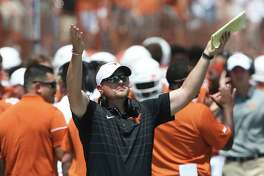 Longhorn coach Tom Herman signals out to the field as Texas plays Maryland at DKR Stadium on September 2, 2017.