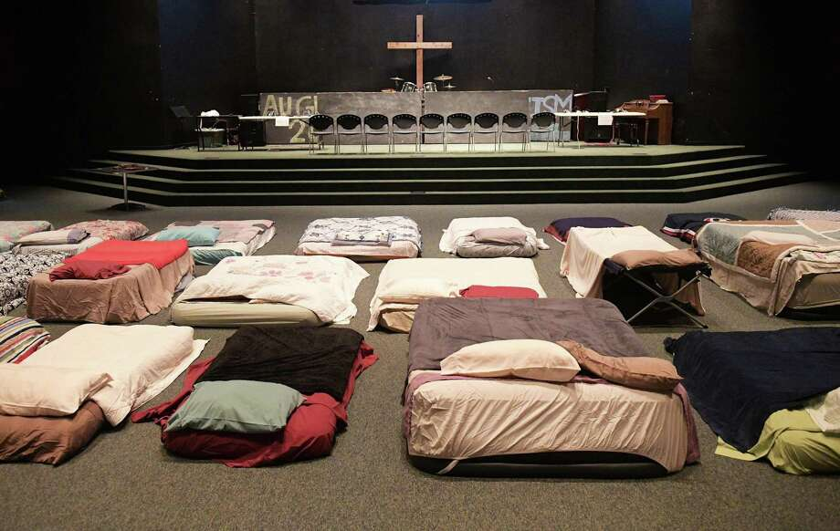 Beds are made ready at a shelter for volunteer rescue workers at Fairfield Baptist Church on Aug. 29, 2017, in Cypress, Texas. Rockport First Assembly of God in Aransas County, Harvest Family Church in Cypress and Hi-Way Tabernacle in Cleveland are suing for disaster relief. Photo: MANDEL NGAN, Contributor / AFP or licensors