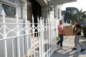 Consulate employees remove boxes from the Russian Consulate in San Francisco, Calif. on Saturday, Sept. 2, 2017 on the day it was ordered to shut down operations by the Trump Administration.