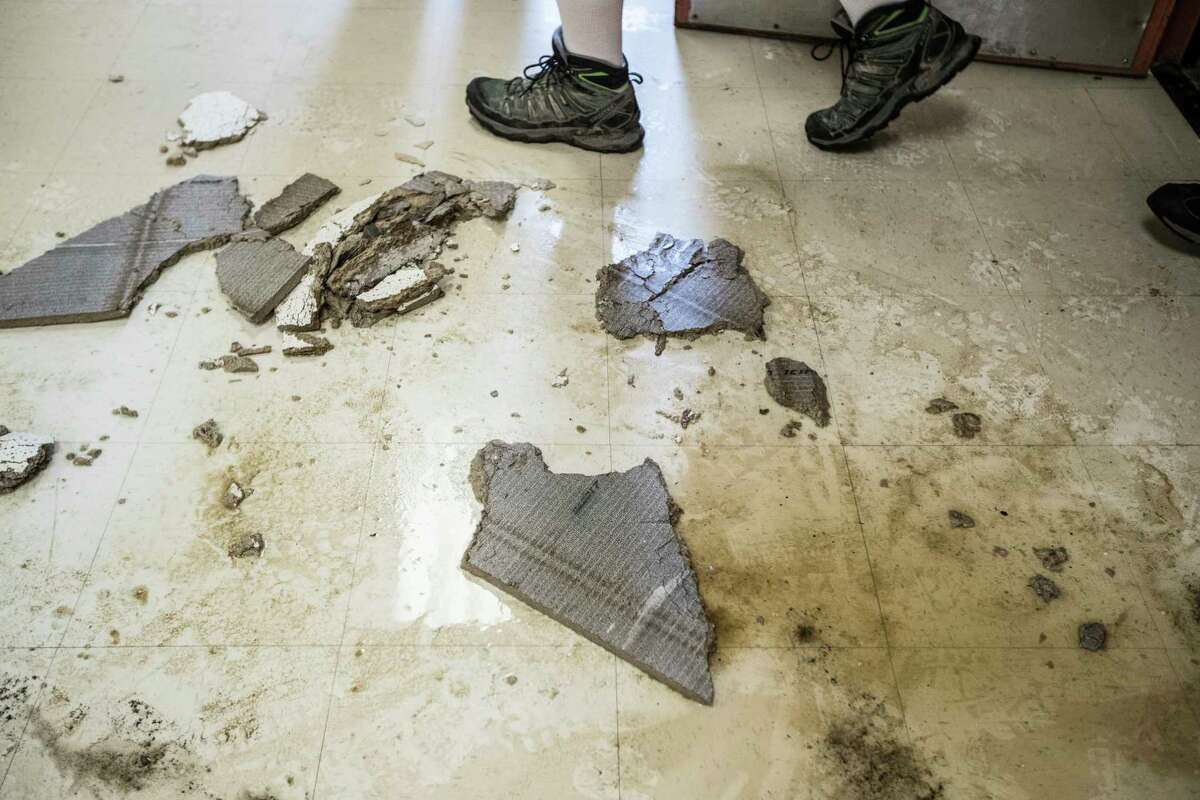 Debris is seen on the floor of A.G. Hilliard Elementary School, which was flooded by Tropical Storm Harvey, on Saturday, Sept. 2, 2017, in Houston.