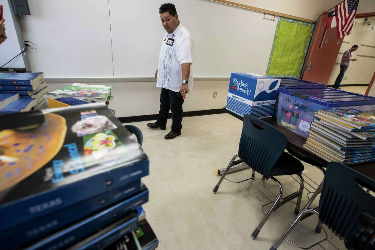 Richard Carranza, Houston Independent School District superintendent, walks through a flood damaged classroom during a tour of A.G. Hilliard Elementary School, which was flooded by Tropical Storm Harvey, on Saturday, Sept. 2, 2017, in Houston.