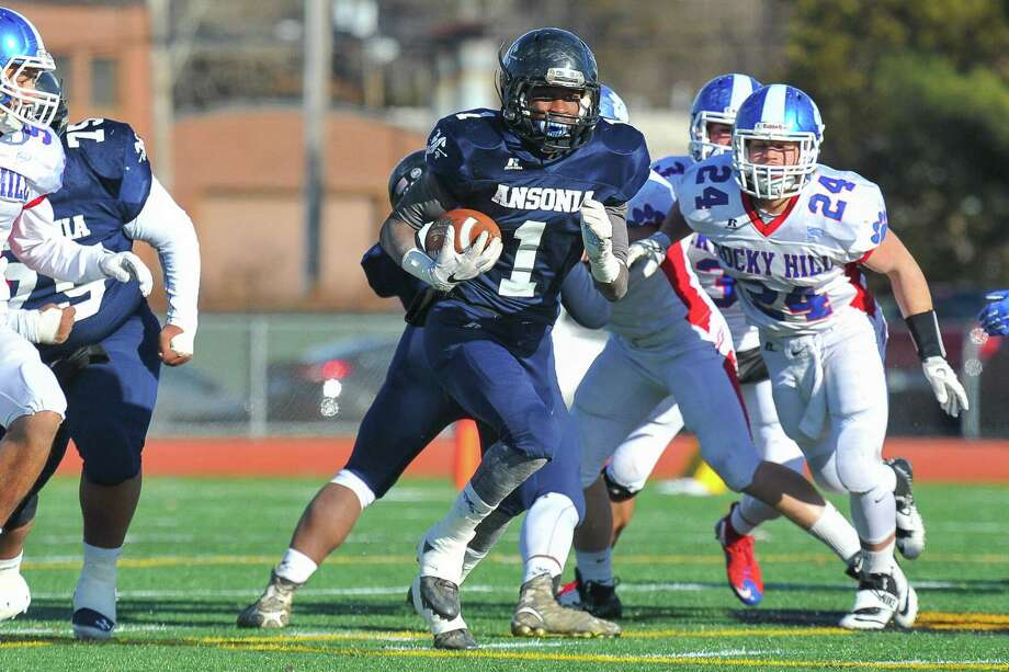 Markell Dobbs (1) of the Ansonia Chargers carries the ball during the Class S State Championship Game against the Rocky Hill Terriers on December 10, 2016 in New Britain, Connecticut. Photo: Gregory Vasil / For Hearst Connecticut Media / Connecticut Post Freelance