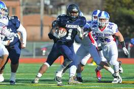 Markell Dobbs (1) of the Ansonia Chargers carries the ball during the Class S State Championship Game against the Rocky Hill Terriers on December 10, 2016 in New Britain, Connecticut.