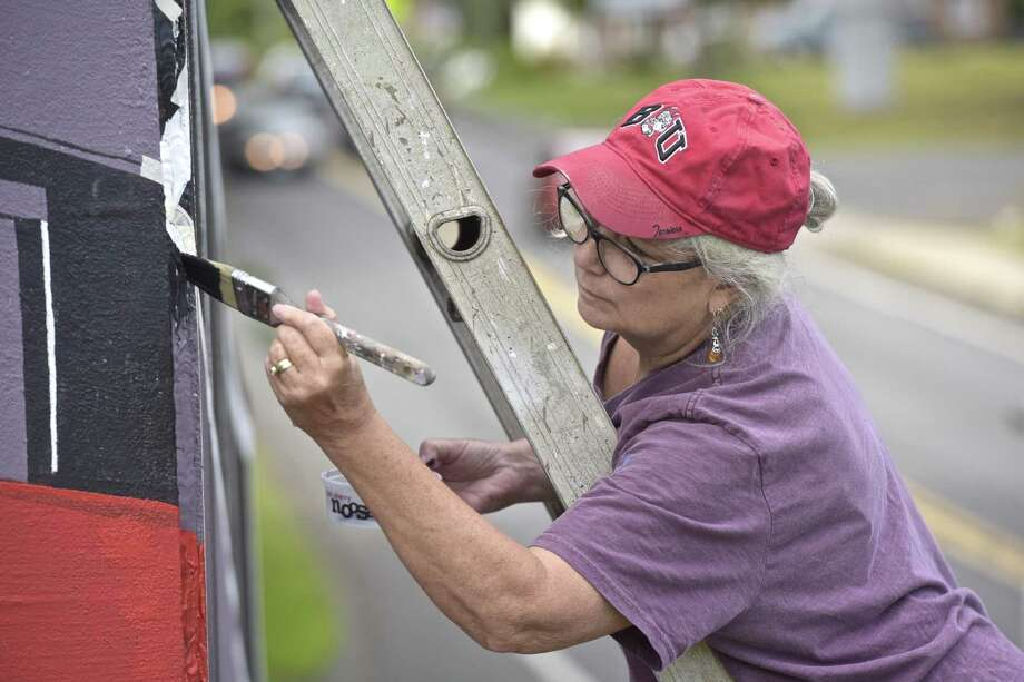 Artist Virginia Zimmerman, of Newtown, is finishing a mural in Newtown with the help of friends. Photo: H John Voorhees III / Hearst Connect Icut Media / The News-Times