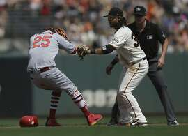 St. Louis Cardinals' Dexter Fowler, left, is tagged out at second base by San Francisco Giants' Brandon Crawford, right, in the fourth inning of a baseball game Saturday, Sept. 2, 2017, in San Francisco. Fowler hit an RBI single which scored Cardinals' Jose Martinez. (AP Photo/Ben Margot)