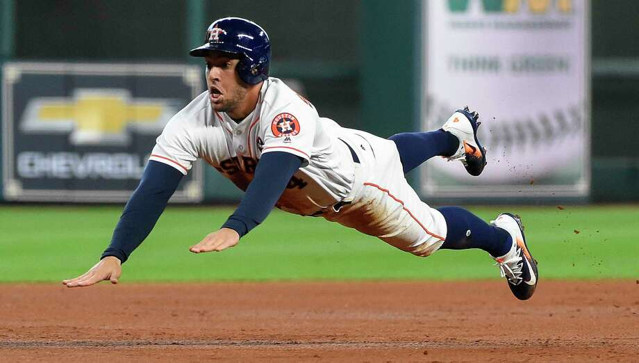 Houston Astros' George Springer slides safely into third on Alex Bregman' single during the first inning of the first game of a baseball doubleheader against the New York Mets, Saturday, Sept. 2, 2017, in Houston. (AP Photo/Eric Christian Smith) Photo: Eric Christian Smith, FRE / FR171023 AP