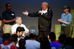 President Donald Trump speaks to volunteers working to sort supplies at a distribution center set up at the First Church of Pearland in the wake of Tropical Storm Harvey Saturday, Sept. 2, 2017.