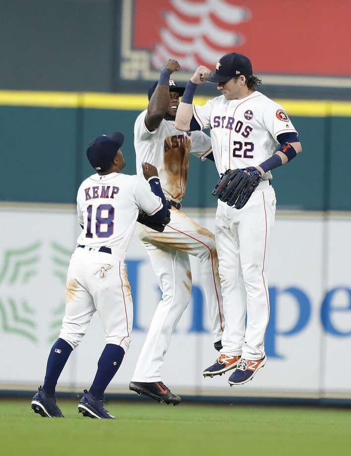 Houston Astros Tony Kemp (18), Cameron Maybin (3), and Josh Reddick (22)try to coordinate their celebration as the Astros win 12-8 over the Mets after game one of their doubleheader during an MLB baseball game at Minute Maid Park, Saturday, Sept. 2, 2017, in Houston.  This is the first professional sporting event in the city since Tropical Storm Harvey. ( Karen Warren / Houston Chronicle ) Photo: Karen Warren/Houston Chronicle