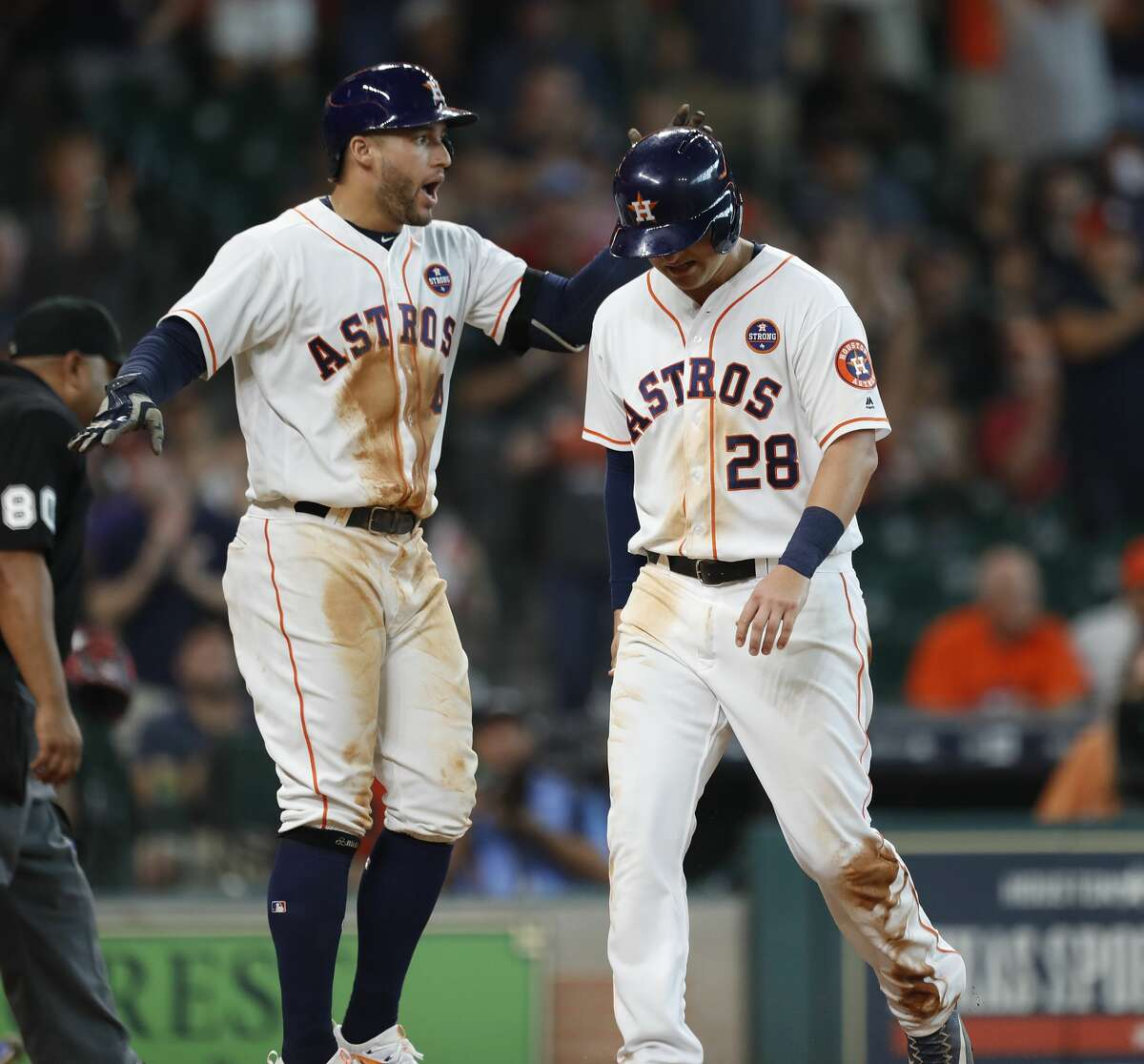Houston Astros third baseman J.D. Davis (28) celebrates with George Springer after Davis scored a run on a single by Tony Kemp in the seventh inning of an MLB baseball game at Minute Maid Park, Saturday, Sept. 2, 2017, in Houston. This is the first professional sporting event in the city since Tropical Storm Harvey. ( Karen Warren / Houston Chronicle )