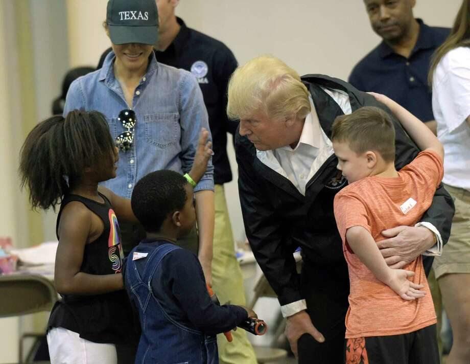 President Donald Trump and Melania Trump meet people impacted by Hurricane Harvey during a visit Saturday to the NRG Center in Houston.  (AP Photo/Susan Walsh) Photo: Susan Walsh, STF / Copyright 2017 The Associated Press. All rights reserved.