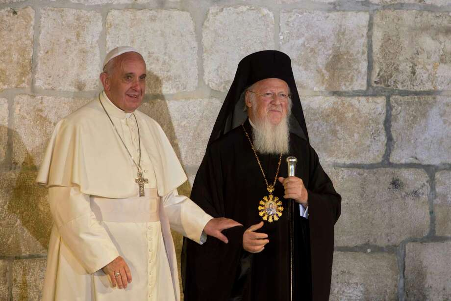 "FILE - In this May 25, 2014 filer, Pope Francis and Ecumenical Patriarch Bartholomew I,  stand before the Church of the Holy Sepulcher in Jerusalem. Pope Francis and the spiritual leader of the world's Orthodox Christians are urging political leaders to ""support the consensus of the world"" that climate change and other environmental ills have created an ecological crisis that is harming the world's poorest the most. (AP Photo/Sebastian Scheiner, File) Photo: Sebastian Scheiner, STF / Copyright 2017 The Associated Press. All rights reserved."