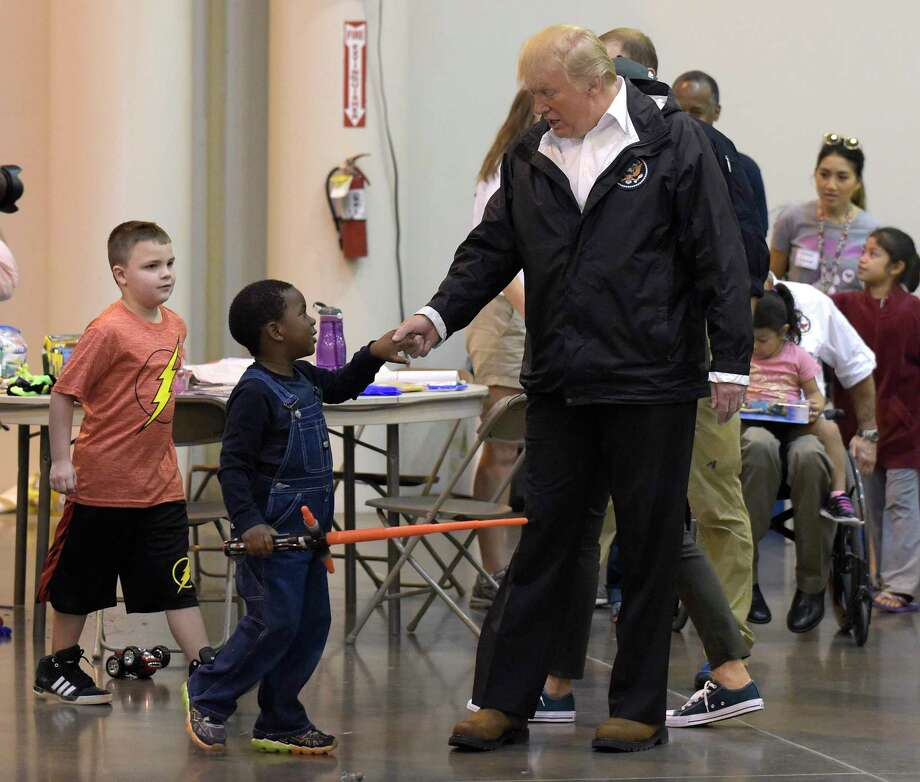 President Donald Trump meets people impacted by Hurricane Harvey during a visit to the NRG Center. It was his second trip to Texas in a week, and this time his first order of business was to meet with those affected by the record-setting rainfall and flooding. Photo: Susan Walsh, STF / Copyright 2017 The Associated Press. All rights reserved.