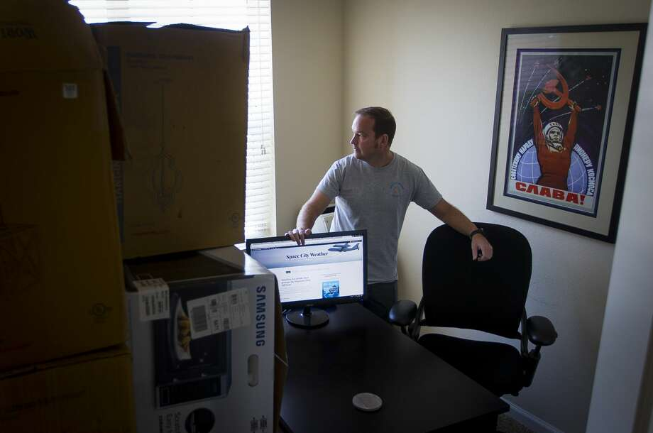 While Hurricane Harvey bore down on the Texas coast, Eric Berger was here, in his third-floor League City apartment with his wife and two children, writing for Space City Weather, the blog that became a valuable resource for weather-watchers before, after and during the storm , Thursday, Aug. 31, 2017, in Houston. Berger is in the process of building a house in League City, and as flood waters began surrounding the new, elevated home, Berger was forced to bring many of the family's possessions stored there into his home office. (Mark Mulligan / Houston Chronicle) Photo: Mark Mulligan/Mark Mulligan / Houston Chronicle