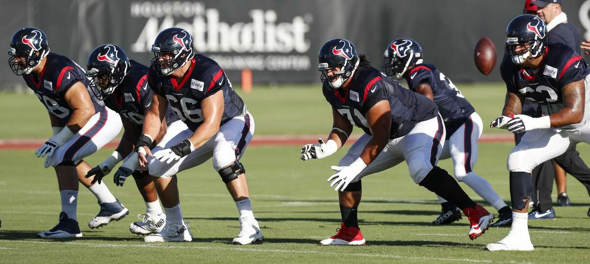 Houston Texans offensive linemen, from left, tackle Breno Giacomini (68), guard Jeff Allen (79), center Nick Martin (66), guard Xavier Su'a-Filo (71) and tackle Kendall Lamm (63) drop back into a pass protection drill during training camp at The Methodist Training Center on Tuesday, Aug. 22, 2017, in Houston. ( Brett Coomer / Houston Chronicle )