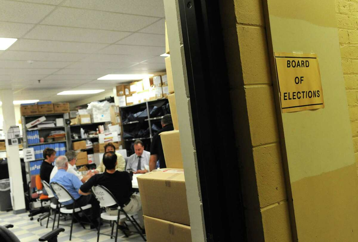 Absentee ballots from the September 10th primary election are examined at the Rensselaer County Board of Elections on Friday Sept. 13, 2013 in Troy, N.Y. (Michael P. Farrell/Times Union)