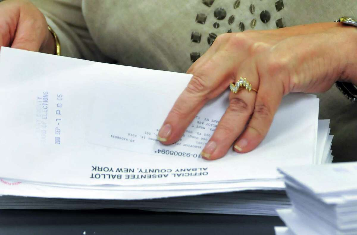Deputy Albany Co. Elections Commishioners count of absentee ballots as representatives of primary candidates watch at the Albany County Board of Elections in Albany Wednesday afternoon September 22, 2010. (John Carl D'Annibale / Times Union)