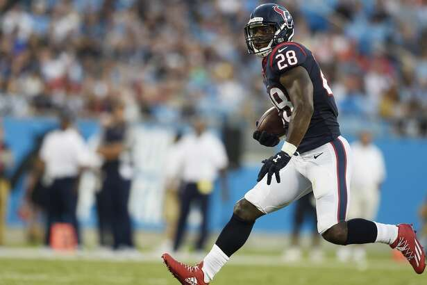 Houston Texans running back Alfred Blue (28) runs against the Carolina Panthers during the first half of an NFL preseason football game, Wednesday, Aug. 9, 2017, in Charlotte, N.C. (AP Photo/Mike McCarn)