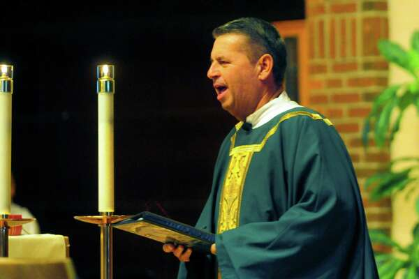 Msgr. Walter Orlowski leads mass at St. Matthew's Church in Norwalk, Conn. on Saturday Sept. 2, 2017. As part of the ongoing effort to bring relief to victims of Hurricane Harvey, Msgr. Orlowski will be driving one of the two large rental trucks filled with supplies down to Our Lady of Guadalupe, the church's adopted Parish in Rosenberg, Texas.