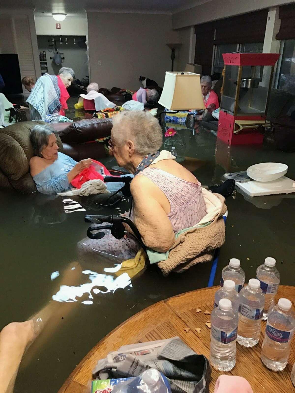 Residents of La Vita Bella nursing home in Dickinson, Texas, sit in waist-deep floodwater.