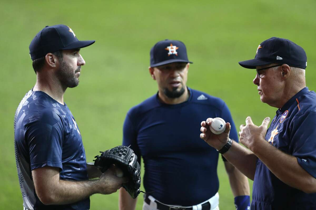 Houston Astros starting pitcher Justin Verlander, freshly arrived from Detroit, chats with pitching coach Brent Strom and bullpen catcher Javier Bracamonte before throwing a bullpen session before the start of game two of a doubleheader of an MLB baseball game at Minute Maid Park, Saturday, Sept. 2, 2017, in Houston. ( Karen Warren / Houston Chronicle )