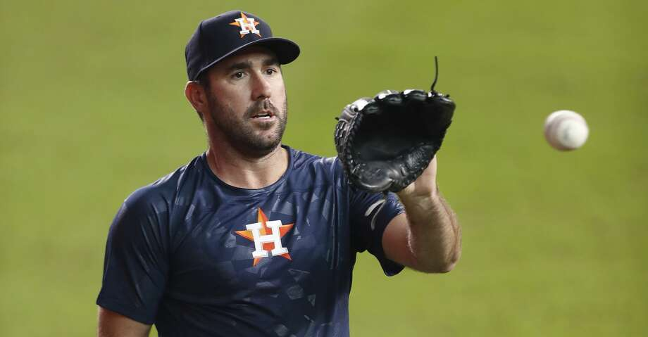 PHOTOS: First look at Justin VerlanderHouston Astros starting pitcher Justin Verlander, freshly arrived from Detroit, warms up before throwing a bullpen session between game one and two of a doubleheader of an MLB baseball game at Minute Maid Park, Saturday, Sept. 2, 2017, in Houston. ( Karen Warren / Houston Chronicle )Browse through the photos to see the first look of Verlander in an Astros uniform. Photo: Karen Warren/Houston Chronicle