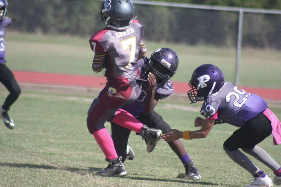 The Pasadena Bears, shown in action from last year, are waiting to play their season opener. A bye date and then Hurricane Harvey has kept the Bears off the field through the opening two weeks of the new TIFI season. Photo: Robert Avery