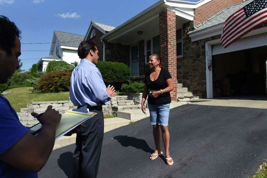 Democratic mayoral candidate Frank Commisso Jr., center,  talks to Valarie Cruz of Albany, right, while campaigning on Beacon Avenue on Wednesday afternoon, Aug. 30, 2017, in Albany, N.Y. (Will Waldron/Times Union) Photo: Will Waldron / 20041413A