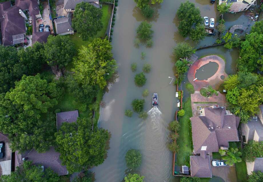 An airboat travels north along S. Kirkwood Rd. west of Beltway 8 and south of Interstate 10 where homes are inundated with water from the overflowing Buffalo Bayou to the north, Saturday, September 2, 2017, in Houston. Houston mayor Sylvester Turner issued a new mandatory evacuation order Saturday for homes with water in them south of Interstate 10, north of Briar Forest, east of Highway 6 and west of Gessner Rd. As water continues to be released from the Addicks and Barker reservoirs. Photo: Mark Mulligan, Houston Chronicle / 2017 Mark Mulligan / Houston Chronicle