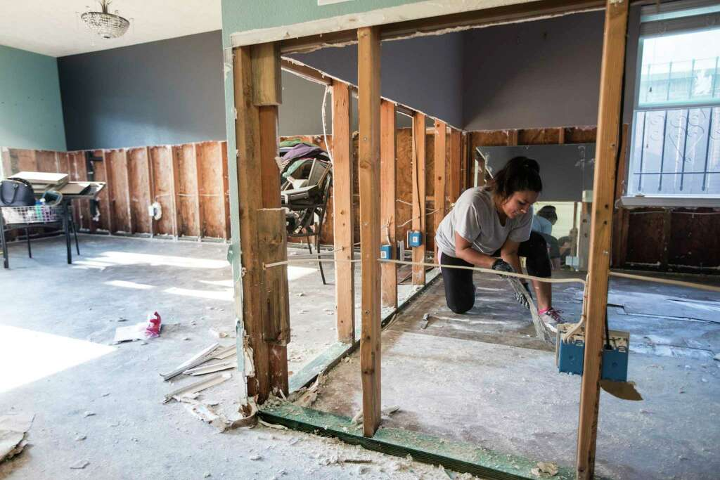 Mayra Rubio Cleans Out Flooring In Her Motheru0027s Flood Damaged Home In A  Neighborhood Built
