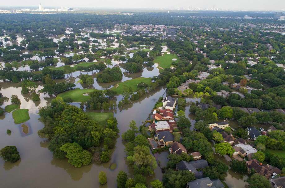 Homes along Lakewood Country Club west of Beltway 8 are inundated with water from the overflowing Buffalo Bayou on Saturday. Mayor Sylvester Turner issued a new mandatory evacuation order Saturday for homes with water in them south of Interstate 10, north of Briar Forest, east of Highway 6 and west of Gessner Road. Photo: Mark Mulligan, Staff Photographer / 2017 Mark Mulligan / Houston Chronicle