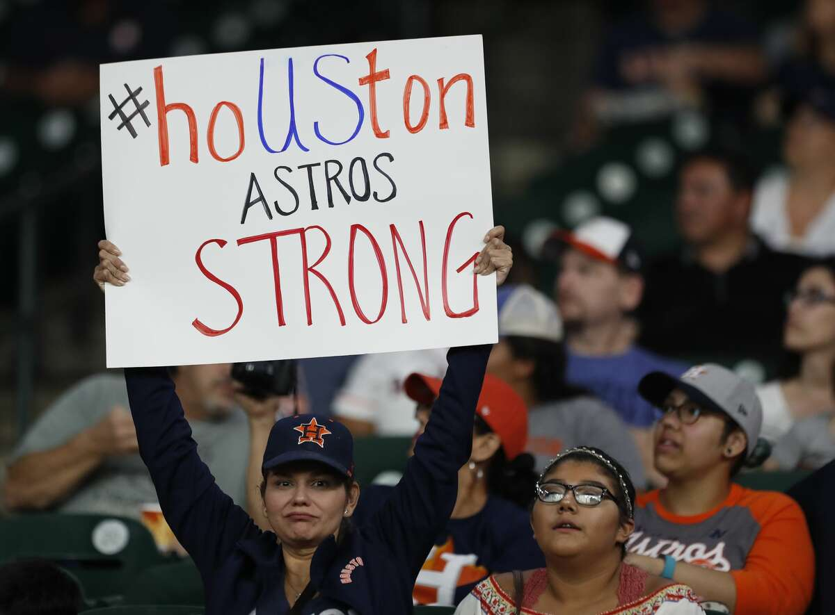 A woman with a Houston Astros Strong sign in the first inning of game two of a doubleheader of an MLB baseball game at Minute Maid Park, Saturday, Sept. 2, 2017, in Houston. ( Karen Warren / Houston Chronicle )