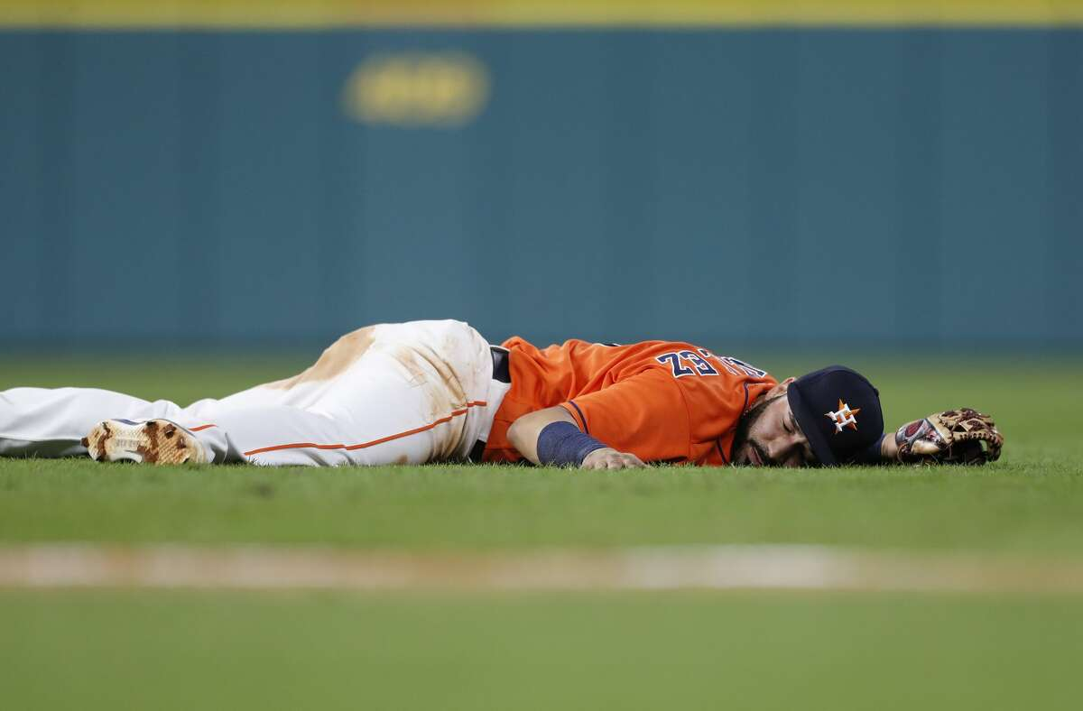 Houston Astros Marwin Gonzalez (9) lies on the field after he made the throw from the ground as New York Mets Brandon Nimmo sharply ground out in the eighth inning of game two of a doubleheader of an MLB baseball game at Minute Maid Park, Saturday, Sept. 2, 2017, in Houston. ( Karen Warren / Houston Chronicle )