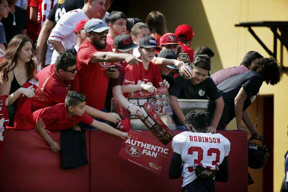 San Francisco 49ers cornerback Rashard Robinson (33) signs autographs for fans during football practice at Levi's Stadium on Saturday, Aug. 5, 2017, in Santa Clara, Calif.