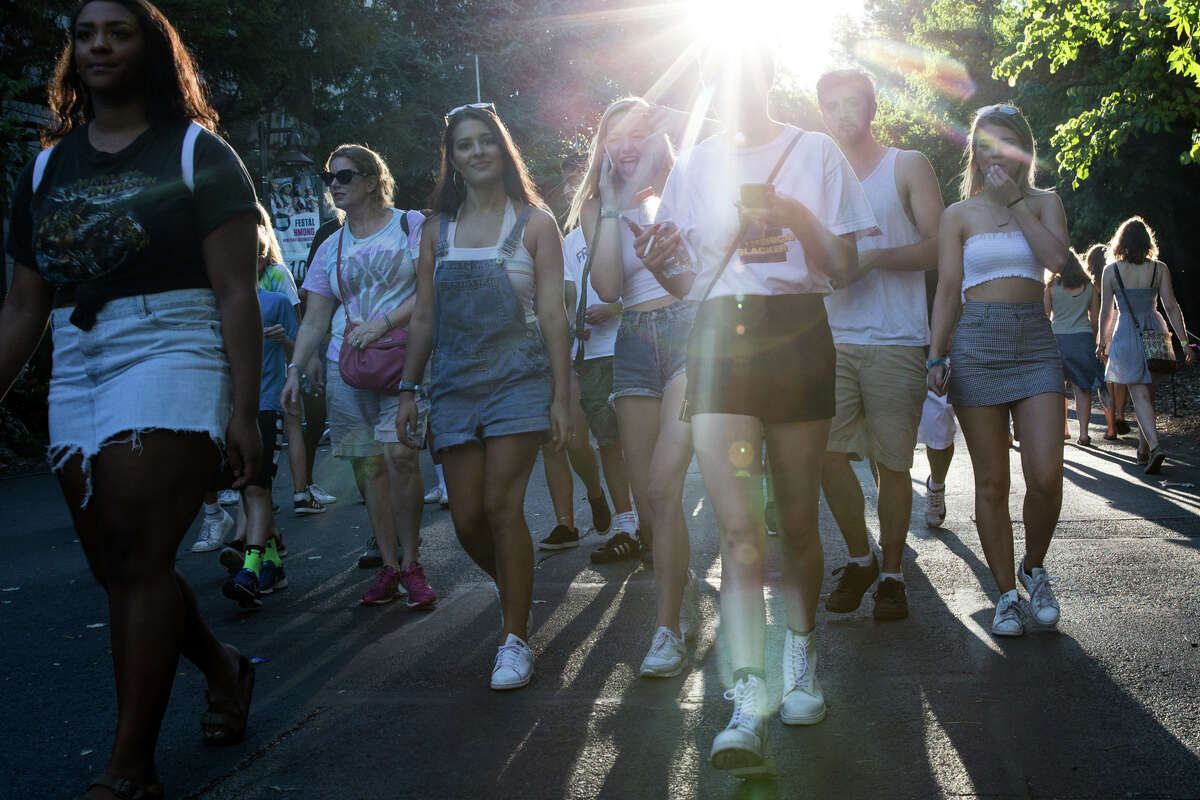 Festivalgoers head to Memorial Stadium during the second day of Bumbershoot at Seattle Center on Saturday, Sept. 2, 2017.