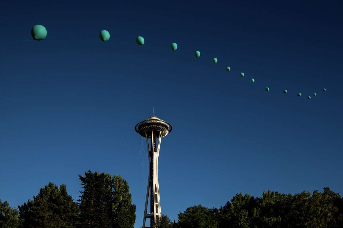 A balloon installation floats across the sky during the second day of Bumbershoot at Seattle Center on Saturday, Sept. 2, 2017.