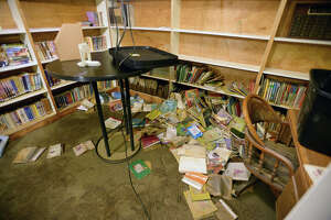 Wet books in the library at Deweyville's United Pentecostal Church on Monday. Residents began returning to their homes on Sunday to begin removing debris and water soaked materials. Photo taken Monday, March 21, 2016 Guiseppe Barranco/The Enterprise