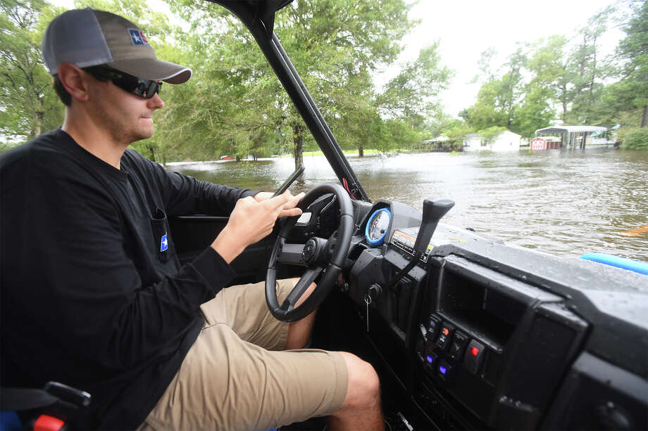Matt Spence looks on his phone while driving through water on FM 365 near Interstate 10 on Tuesday. The mass of accurate and inaccurate information on social media has helped and hindered emergency response to Hurricane Harvey.  Photo taken August 28, 2017 Guiseppe Barranco/The Enterprise Photo: Guiseppe Barranco, Photo Editor / Guiseppe Barranco ©