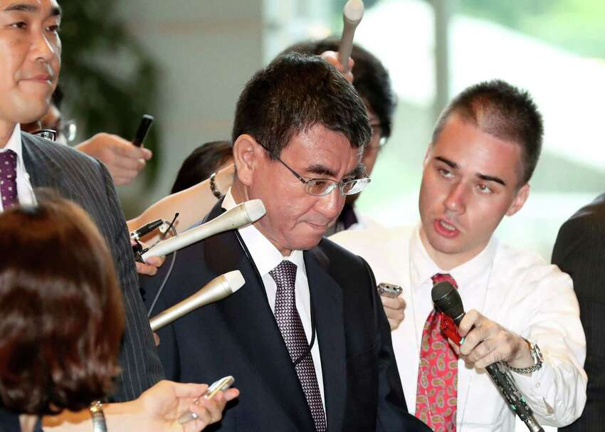Japan's Foreign Minister Taro Kono is surrounded by reporters as Kono arrived at the prime minister's official residence for a national security meeting in Tokyo, Sunday, Sept. 3, 2017. Japan confirmed that North Korea conducted a nuclear test, Foreign Minister Kono said.
