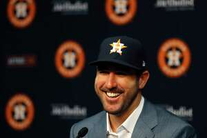 Houston Astros pitcher Justin Verlander speaks to the media before the start of an MLB baseball game at Minute Maid Park, Sunday, Sept. 3, 2017, in Houston, after he was acquired Thursday.