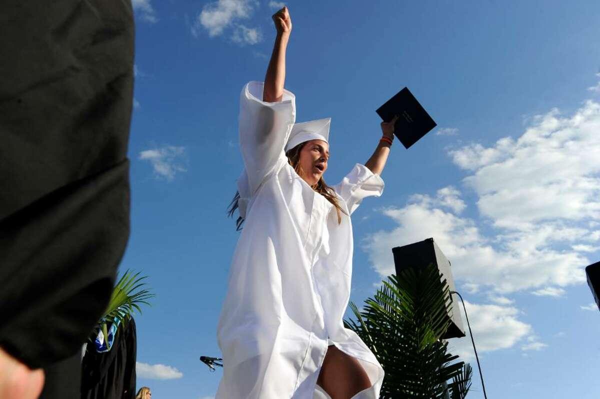 Paige Gasparino celebrates receiving her diploma during Darien High School Class of 2010 graduation Monday June 21, 2010.