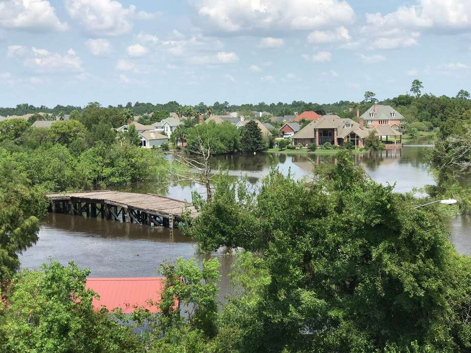 View from bridge into orange from bridge city lots of neighborhoods still flooded out Sept. 3, 2017 Photo: Kim Brent