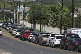 Cars line up for gas at a Valero station in San Antonio on August 31, 2017.