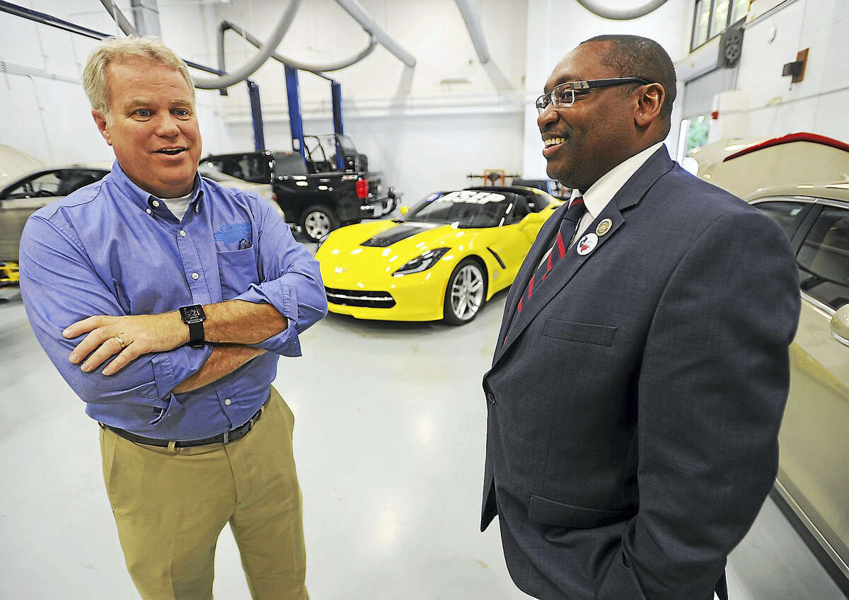 Professor Daniel Fuller, left, shows Housatonic and Gateway Community College President Paul Broadie the Automotive Technology program at Gateway Community College's North Haven campus.