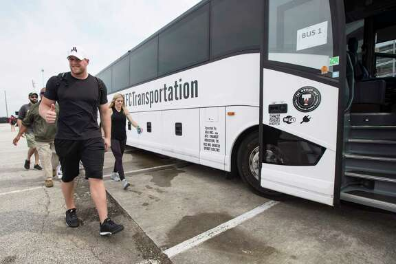 NFL Houston Texans defensive end J.J. Watt gives a thumbs up as he gets ready to lead his teammates in distributing relief supplies to people impacted by Hurricane Harvey on September 3, 2017, in Houston.   Watt's Hurricane Harvey Relief Fund has raised more than $18 million to date to help those affected by the storm. / AFP PHOTO / POOL / Brett COOMERBRETT COOMER/AFP/Getty Images