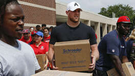 Houston Texans Dee Virgin, J.J. Watt and D.J. Reader while distribute relief supplies to people impacted by Hurricane Harvey on Sunday, Sept. 3, 2017, in Houston. J.J. Watt's Hurricane Harvey Relief Fund, which raised more than $17 million to date to help those affected by the storm.