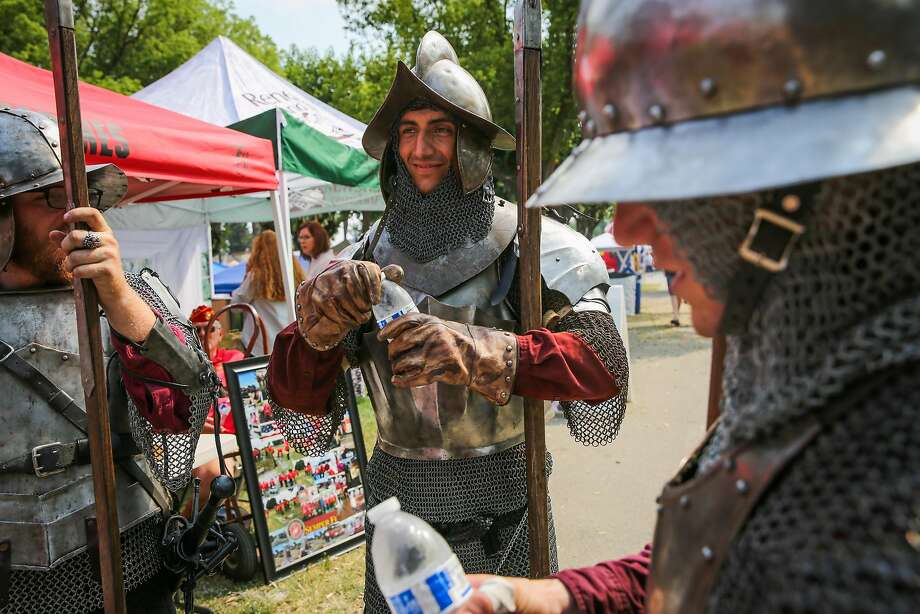 Kendrick Cobb (left), Julian Galves and David Samuelson, dressed as royal guards despite the heat at the Highland Gathering and Games in Pleasanton. Photo: Gabrielle Lurie, The Chronicle