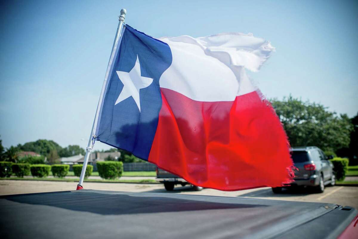 A Texas flag attached to a pickup truck waves outside a shelter in Port Arthur, Texas, on September 2, 2017. Voters are being asked to consider seven amendments to the state constitution.