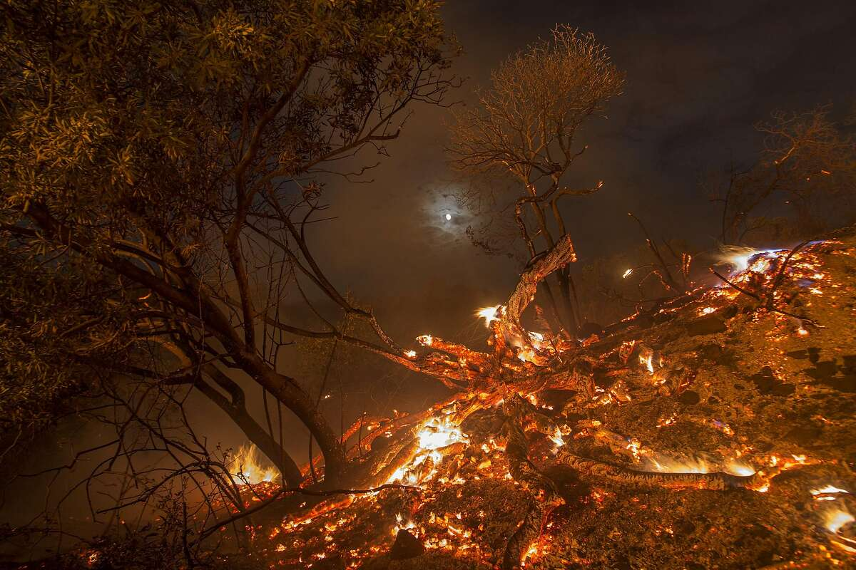 Flames spread on a moonlit night at the La Tuna Fire on September 2, 2017 near Burbank, California. Los Angeles Mayor Eric Garcetti said at a news conference that officials believe the fire, which is at 5,000 acres and growing, is the largest fire ever in L.A. People have been evacuated from hundreds of homes in Sun Valley, Burbank and Glendale.