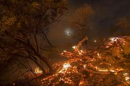 BURBANK, CA - SEPTEMBER 02: Flames spread on a moonlit night at the La Tuna Fire on September 2, 2017 near Burbank, California. Los Angeles Mayor Eric Garcetti said at a news conference that officials believe the fire, which is at 5,000 acres and growing, is the largest fire ever in L.A. People have been evacuated from hundreds of homes in Sun Valley, Burbank and Glendale. About 100 Los Angles firefighters are expected to return soon from Texas, where they've been helping survivors from Hurricane Harvey.    (Photo by David McNew/Getty Images)