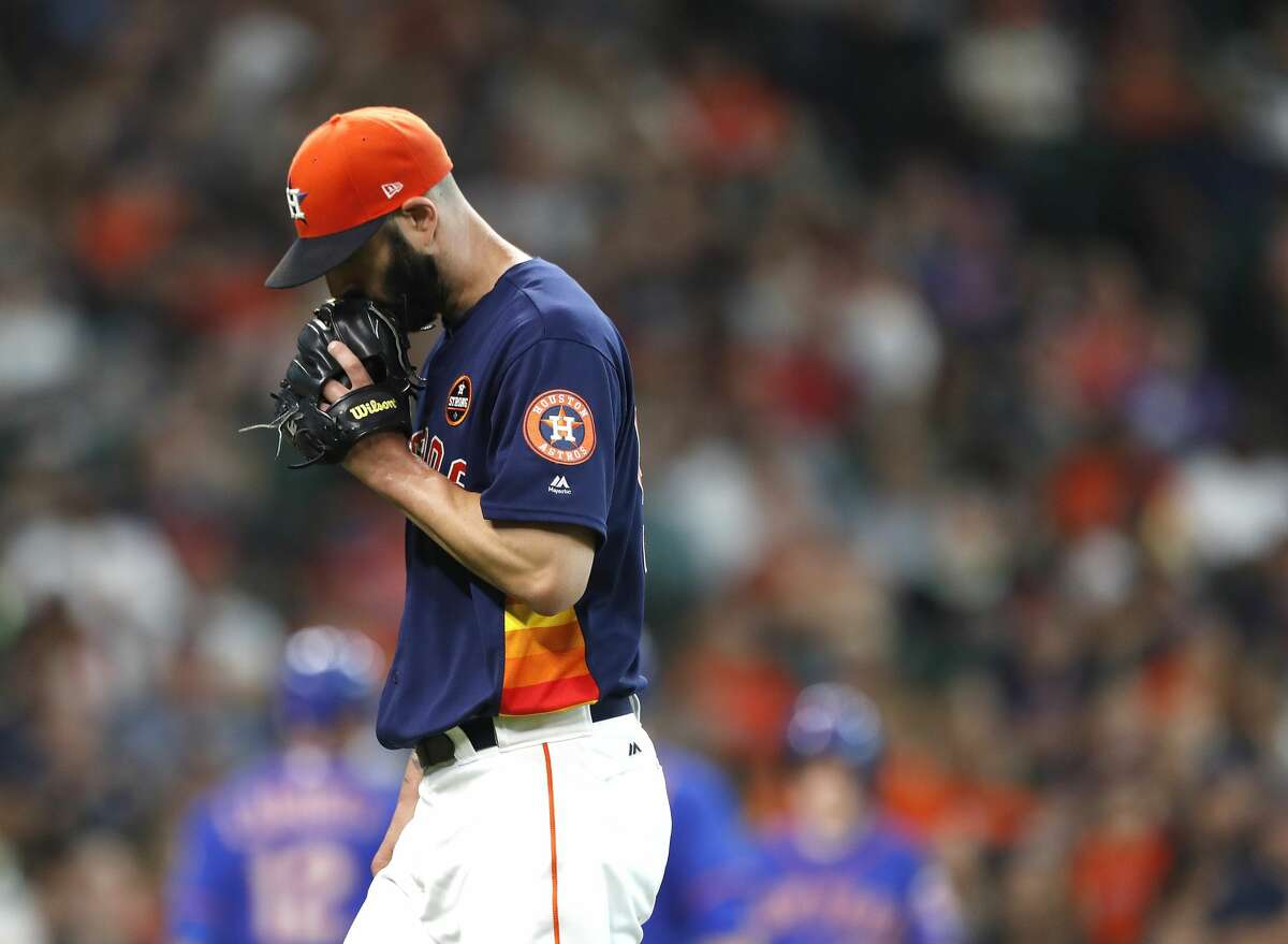 Houston Astros starting pitcher Mike Fiers (54) covers his face with his glove as he walks back to the dugout after giving up two runs during the second inning of an MLB baseball game at Minute Maid Park, Sunday, Sept. 3, 2017, in Houston. ( Karen Warren / Houston Chronicle )